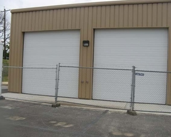 Finish Exterior Metal Wall Panel and Overhead Door at the Jet Truck Garage