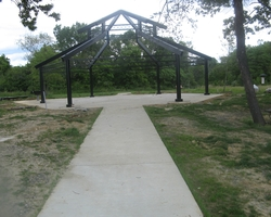 Concrete Walkway leading to Picnic Pavilion at Birchwood Community Center